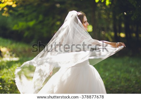 beautiful bride circling in the park