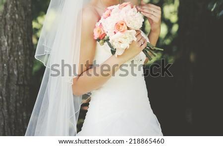 Beautiful bride enjoying happy wedding day.  - stock photo