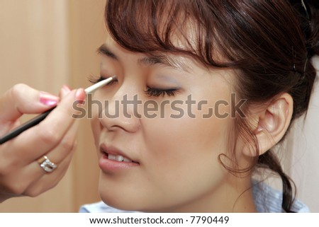 beautiful bride getting ready for wedding. make-up