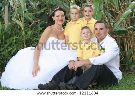 beautiful bride groom and children - stock photo