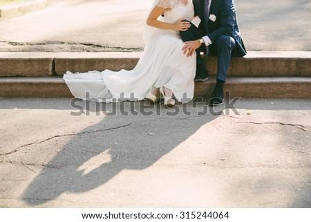 Beautiful bride hugs groom, wedding, marriage, relationship, lifestyle - stock photo