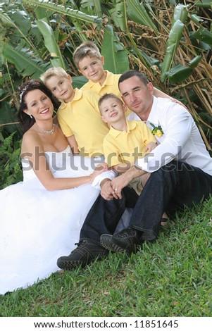 beautiful bride, husband and children - stock photo