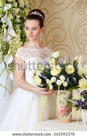 beautiful bride in a luxurious wedding dress - stock photo