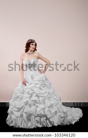beautiful bride in a wedding dress - stock photo