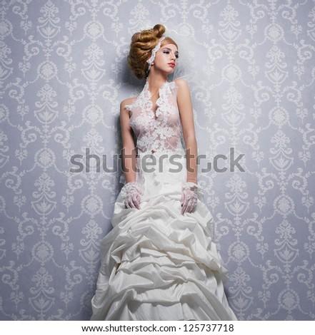 Beautiful bride in elegant white lace wedding dress - stock photo