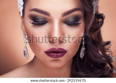 Beautiful bride in studio on brown background - stock photo
