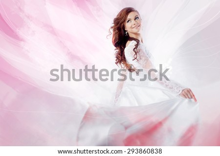 Beautiful bride in wedding dress,  abstract soft pink background    - stock photo