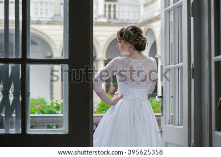 Beautiful bride in wedding dress before wedding ceremony - stock photo