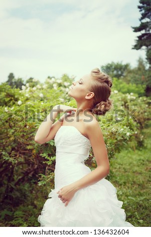 Beautiful bride in white wedding dress, outdoors