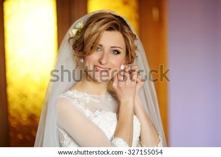 Beautiful bride  indoor near the window - stock photo