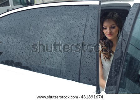 Beautiful bride inside  the wedding limo - stock photo