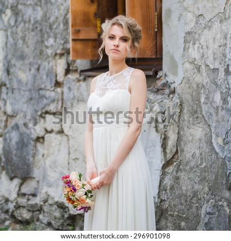 Beautiful bride on your wedding day with a big bouquet - stock photo