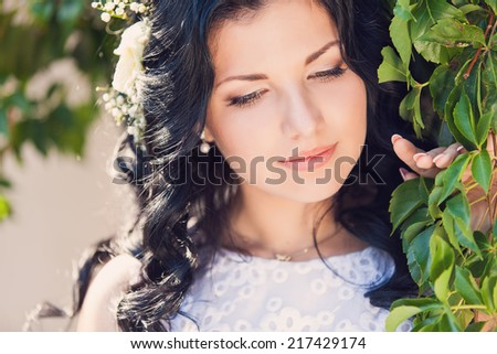 Beautiful bride outdoors - stock photo