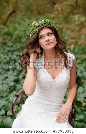 Beautiful bride outdoors in a autumn forest.