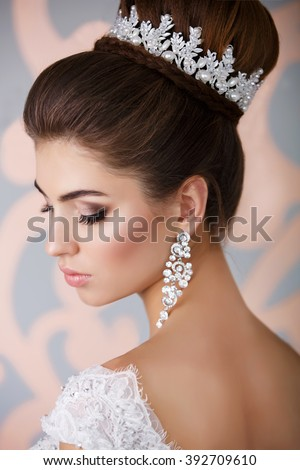 Beautiful Bride Portrait wedding makeup and hairstyle, girl in diamonds tiara, jewelry model, fashion bride gorgeous beauty, smiling happy bride woman, series - stock photo