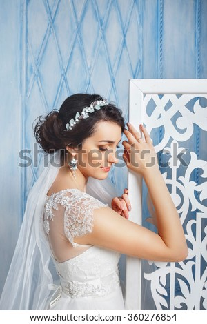 Beautiful Bride Portrait wedding makeup, wedding hairstyle, Wedding dress. Wedding decoration. soft selective focus. gorgeous young bride at interior - stock photo