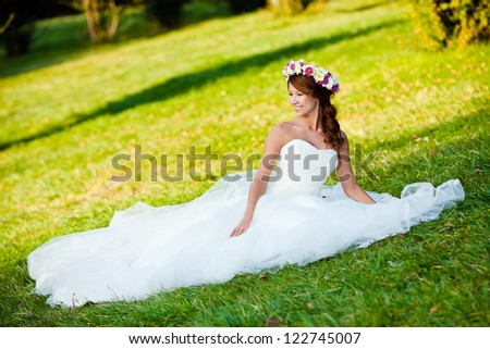 beautiful bride portrait with flowers at park for wedding