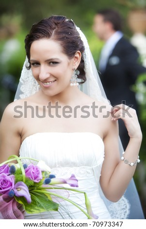 Beautiful bride posing for the camera her wedding day. - stock photo