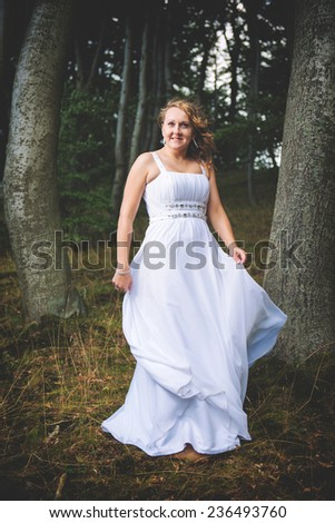 Beautiful bride posing in the forest