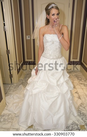Beautiful bride shocked about getting married - stock photo