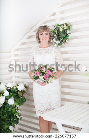 Beautiful bride standing near wall. Newlyweds. wedding