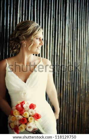 beautiful bride stunning bouquet set against rustic background - stock photo