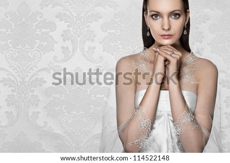 beautiful bride wearing a dainty jewellery. Space for text. - stock photo