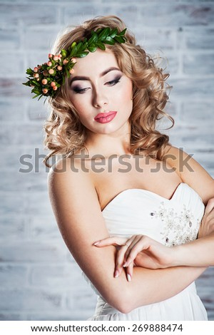 Beautiful bride wearing a wreath - stock photo