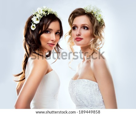 Beautiful bride wearing white wedding dress stock photo 189449858 beautiful bride wearing white wedding dress with flowers on her head junglespirit Image collections