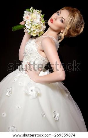 Beautiful bride. Wedding hairstyle and make up - stock photo