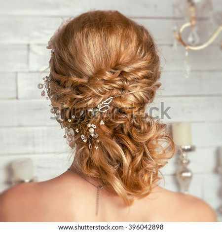 Beautiful Bride wedding hairstyle with hair ornaments. Soft selective focus.