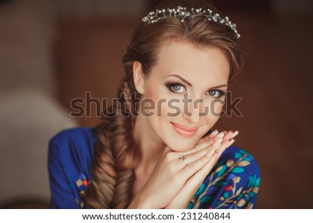 Beautiful bride wedding makeup and hairstyle. Young happy bride at marriage day. portrait of young bride at bridal day. soft tonality, selective focus, series. - stock photo