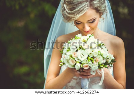 beautiful bride with a wedding bouquet - stock photo