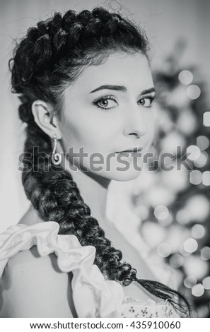 Beautiful bride with black hair, braided in a braid, the morning of the wedding day, winter, New Year's Eve, closeup, portrait