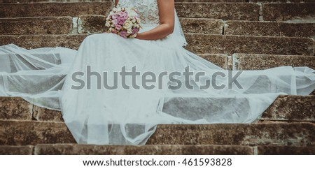 Beautiful bride with bouquet on wedding day.