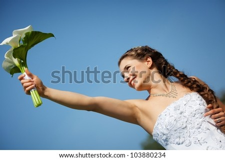 Beautiful bride with callas flowers - stock photo