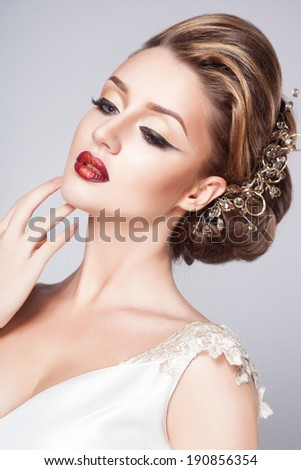 Beautiful bride with fashion hairstyle and make-up - stock photo