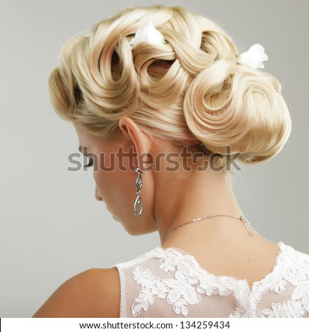 Beautiful bride with fashion wedding hairstyle - on white background - stock photo