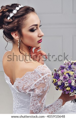 Beautiful bride with fashion wedding hairstyle - on white background.Closeup portrait of young gorgeous bride. Wedding. Studio shot.Beautiful bride portrait with veil over her face - stock photo