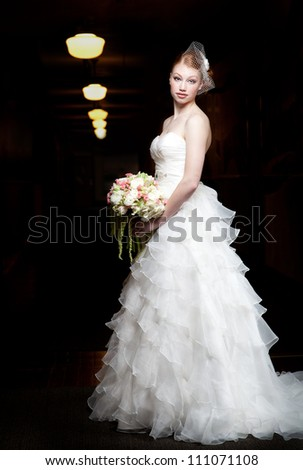 Beautiful bride with red hair. - stock photo