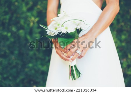 Beautiful Bride with Wedding Bouquet, Close up detail. Soft focus, Shallow depth of field. - stock photo