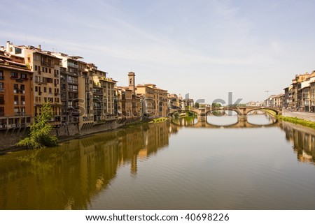 Beautiful bridge and reflection in the Arno River in Florence Italy shot from Ponte Vecchio