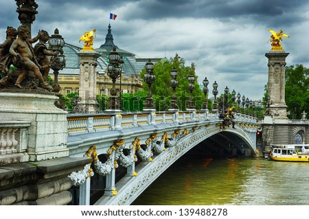 Beautiful bridge of Alexandre III in Paris at cloudy day - stock photo