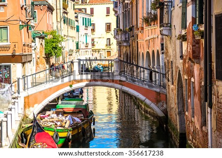 Beautiful bridge over the canal in the old town of Venice - stock photo