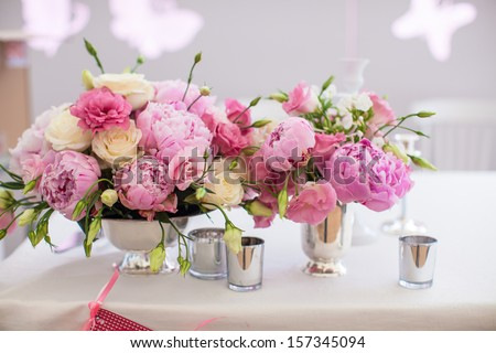 Beautiful bright bouquet of peony on the wedding table in vase - stock photo