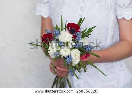 Beautiful bright bridal bouquet in bride hands