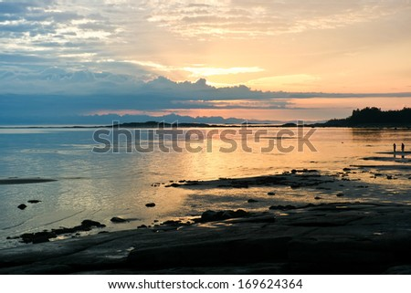 Beautiful bright colorful sunset over White sea - stock photo