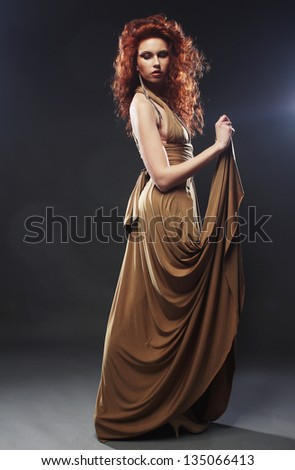 beautiful bright red hair woman in long dress