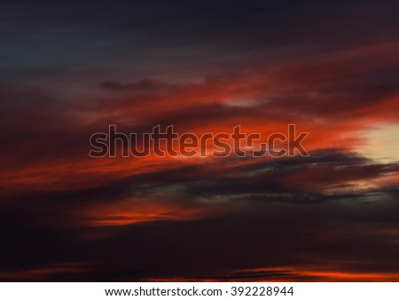 Beautiful bright sunset. Cloudy sky. Orange, red, and gray colors