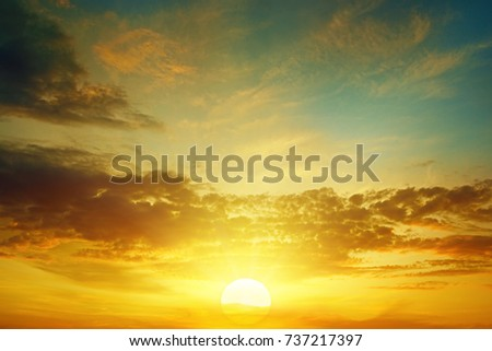 beautiful bright sunset in cloudy sky